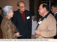 Yee Wah Jung and Kwan Y. Jung, fellow National Academician with exhibit framer, Manuel Castanon