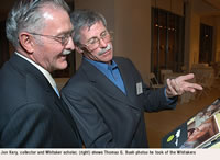 Jon Kery, collector and Whitaker scholar (right) shows Thomas G. Bush photos he took of the Whitakers