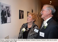 Whitaker Foundation Board Member Bruni Bush and Whitaker Foundation Chairman Thomas G. Bush look at photo of Fred and Eileen, taken in 1966